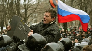 A pro-Russian demonstrator scuffles with police during a rally in Donetsk.