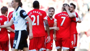 Southampton players embrace Jay Rodriguez after he scores against the Canaries.