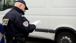French police officers control cars with number plates ending in even numbers.