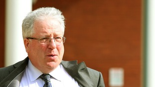 Transport Secretary Patrick McLoughlin leaves Preston Crown Court after giving evidence.