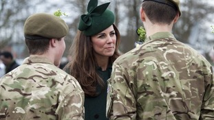 Kate hands out the sprigs to some of the Guards.
