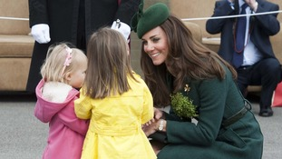 Kate talks to two young girls at the parade.
