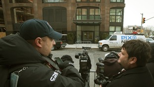 The media gather outside L'Wren Scott's Manhattan apartment.