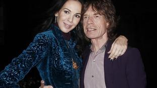 Musician Mick Jagger and designer L'Wren Scott.