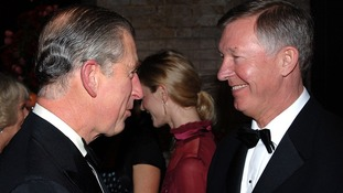 Prince Charles, Prince of Wales shakes hands with Sir Alex Ferguson.