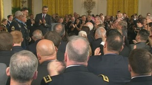 US President Barack Obama and guests at the White House applaud the Medal of Honor recipients.