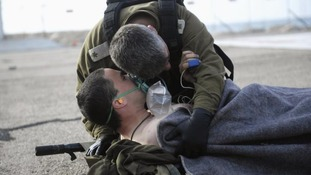 An Israeli army officer listens to a soldier who was wounded during the attack.