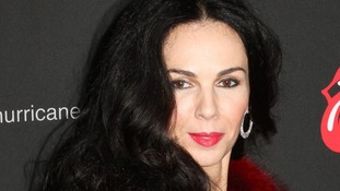 File photo of fashion designer L'Wren Scott .