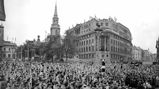 A crowd gathered in Trafalgar Square, London,  to get a glimpse of the Queen's coach as it passed in procession for the Coronation