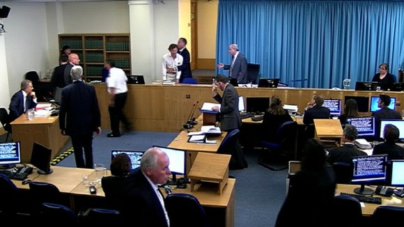 A protester interrupts Blair&#x27;s evidence, branding him a &quot;war criminal&quot;.