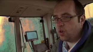 CU man in tractor cab