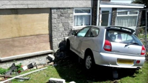 Car hit house in Barry