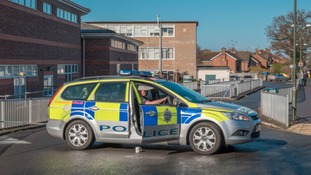 A police car outside Millais School in Horsham