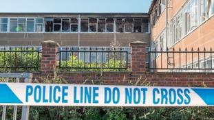 Police tape outside fire-damaged Millais School