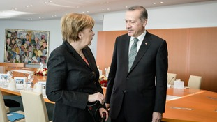 Angela Merkel with Turkish PM Recep Tayyip Erdogan, who has vowed to 'wipe out' Twitter in his country.