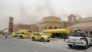 Firefighters attempt to extinguish a fire at the Villagio Mall in Doha