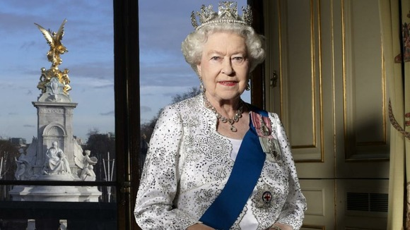 Official portrait of The Queen taken in the Centre Room in Buckingham Palace in December 2011