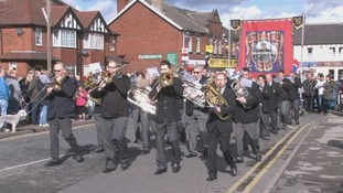 Brass band leads parade to mark miners' strike anniversary