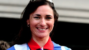 Dame Sarah Storey showing off her medals to the Olympic crowds.
