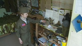The little boy with a military museum in his bedroom