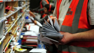Royal Mail staff sort post.