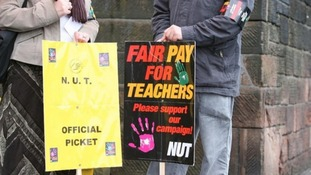File photo of two people on an NUT picket line.