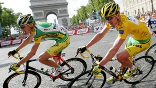 Floyd Landis (right) on the Champs-Elysees