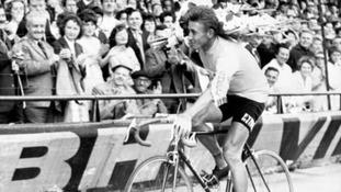 Jacques Anquetil performs a lap of honour around the Parc des Princes velodrome after winning his second Tour