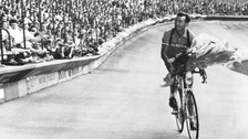 Louison Bobet performs a lap of honour around the Parc des Princes after winning his third consecutive Tour