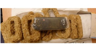 Several of the Weetabix had been hollowed out to fit the mobile phone along the centre.