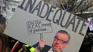 "A protestor's placard, labelling Education Secretary Michael Gove ""inadequate"""