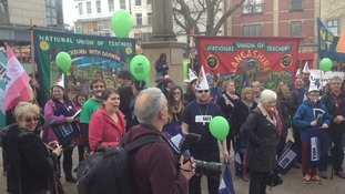 Teachers with banners, balloons and whistles at rally in Preston