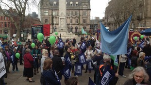 Crowd of teachers with NUT banners and balloons in Preston