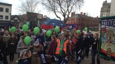 Striking teachers at a rally in Preston with banners, whistles and balloons