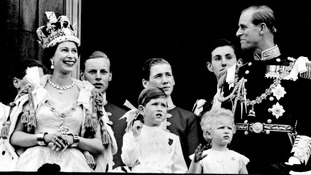 Queen Elizabeth II and the Duke of Edinburgh with members of the Royal Family on the balcony at Buckingham Palace after her Coronation