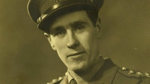 "Captain Raymond ""Jerry"" Roberts seen in military uniform."