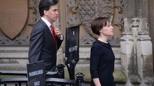 Labour leader Ed Miliband and his wife Justine make their way to the service.