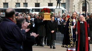 Tony Benn's coffin is carried in by members of his family, including his son Hillary, a serving MP.