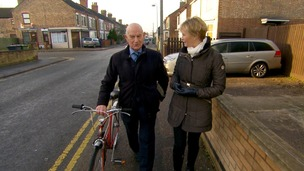 Julie Etchingham talking to man as walk along street