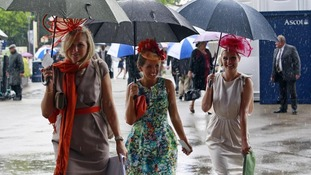Women arrive for Ladies Day, the third day of racing at Royal Ascot in southern England
