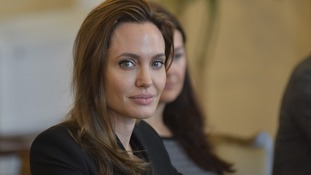 UNHCR goodwill ambassador Angelina Jolie sits for a meeting in Bosnia.