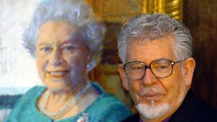 Rolf Harris unveils his new portrait of Britain's Queen Elizabeth II at the Queen's Gallery, Buckingham Palace,