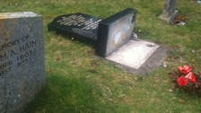 Vandalism in graveyard in Warwickshire