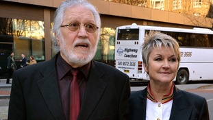Dave Lee Travis outside Southwark Crown Court with his wife Marianne.