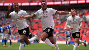 Britt Assombalonga celebrates making it 3-1.