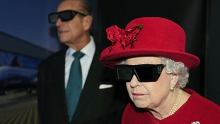 The Queen and the Duke of Edinburgh wearing 3D glasses to watch a display during a visit to the University of Sheffield
