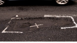 Which borough repaired the most potholes last year?