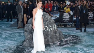 Emma Watson dazzles in a white Ralph Lauren gown at the UK premiere of Noah.