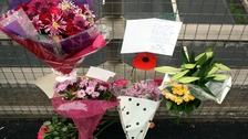 Flowers and tributes left on a bridge overlooking the M5 at Taunton, Somerset