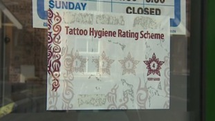 A sticker in the window of a salon achieving full marks in the new hygiene rating system.
